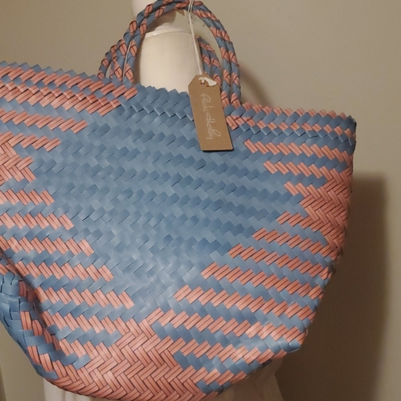 This hand woven unique pink and blue tote